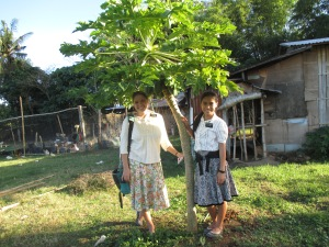 Sis Romano and I by a little teeny papaya tree :)